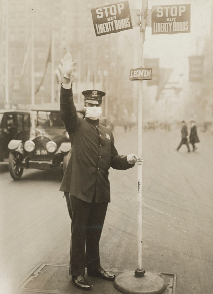 Medical_Department_-_Influenza_Epidemic_1918_-_Masks_for_protection_against_influenza._Traffic__cop__in_New_York_City_wearing_gauze_mask_-_NARA_-_45499301_(cropped)